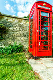 Traditional red telephone box in UK Stock Images