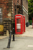 Traditional red telephone box in UK stock photography