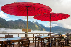 Traditional red Thai umbrellas in cafe Royalty Free Stock Photography