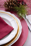 Traditional red theme festive table place setting. Stock Images