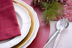 Traditional red theme festive table place setting. Royalty Free Stock Photos
