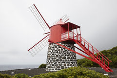 Traditional red and white windmill in Pico island, Azores. Portu stock images