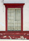 Traditional red window. A traditional red work made of wood with peeling red paint Stock Photography