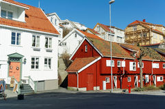 Traditional red wooden buildings, Norway. Kragero, Telemark. Norway - February 2015. Colorful wooden buildings, white buildings, red buildings along the street stock image