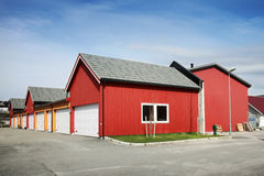 Traditional red wooden Norwegian garages. Traditional rural red and yellow wooden Norwegian garages stock photography