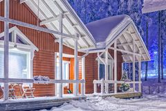 Traditional Reddish Lapland Suomi Houses Over the Polar Circle in Finland at Christmas Time. Travel Destinations Concepts. Traditional Reddish Lapland Suomi Stock Photo