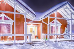 Traditional Reddish Lapland Suomi Houses. Travel Destinations Concepts. Traditional Reddish Lapland Suomi Houses Over the Polar Circle in Finland at Christmas Royalty Free Stock Image