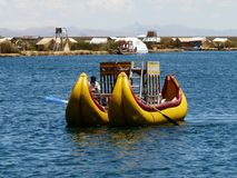Yellow catamaran of Totora on the lake of Titicaca, Peru royalty free stock photo