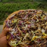 Tlayuda. A regional mexican food. A traditional, regional food in Mexico. A large fried tortilla with various toppings. This one has cured beef, beans, cabbage Royalty Free Stock Images