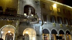 Traditional religious ceremony for the feast of the Immaculate Conception: floral tribute of the italian firemen to the statue. Of the Madonna on the facade of stock footage