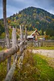 Traditional religious cross symbol with autumn scenery background in Bucovina. Traditional religious cross symbol with autumn scenery background with colorful Stock Images