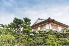 Traditional residential building Arashiyama Japan. Traditional residential building with a beautiful garden in Arashiyama. Kyoto prefecture, Japan Royalty Free Stock Images