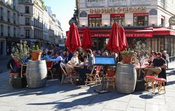 A traditional restaurant A La Place St Georges in Paris in St.Georges Square. Parisians and tourists enjoy food and drinks on the. PARIS FRANCE -OCTOBER 14, 2017 stock photos