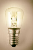 Traditional retro glowing light bulb Stock Photography