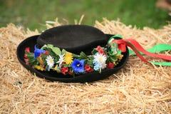 Traditional retro swiss folklore hat. Traditional swiss folklore hat on straw stock photos