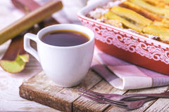 Traditional rhubarb pie with espresso coffee for breakfast. Royalty Free Stock Photo