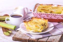 Traditional rhubarb pie with espresso coffee for breakfast. Stock Photos