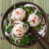 Traditional rice noodle soup with fish balls top view Stock Photos