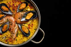 Traditional rice in paella with fish and meat. Stock Photography