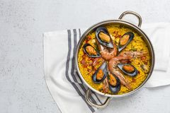 Traditional rice in paella with fish and meat. Royalty Free Stock Photography