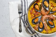 Traditional rice in paella with fish and meat. Royalty Free Stock Photos