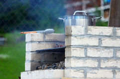 Traditional rich bbq fireplace, made from brics, in garden Royalty Free Stock Photo