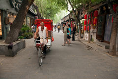 Traditional rickshaw in the old Hutongs of Beijing stock photos