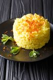 Traditional risotto alla milanese with saffron is decorated with. Mint closeup on a plate on the table. vertical Stock Image