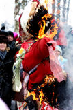 Traditional rite of the burning of the effigy. Send-offs of winter.  People look, as the effigy burns Stock Photo