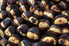 Traditional roast chestnuts. Detail of traditional winter roast chestnuts stall. ready to eat Royalty Free Stock Photos