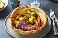 Roast dinner with beef. Traditional roast dinner with beef, carrots, brussel sprouts and gravy royalty free stock images