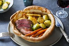 Roast dinner with beef. Traditional roast dinner with beef, carrots, brussel sprouts and gravy stock photos
