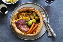 Roast dinner with beef. Traditional roast dinner with beef, carrots, brussel sprouts and gravy stock image
