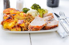 Traditional roast pork Sunday roast. Royalty Free Stock Photo
