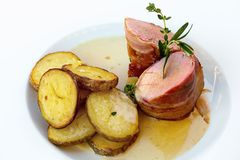 Traditional roasted pork tenderloin wrapped in prosciutto Royalty Free Stock Image
