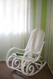 A traditional rocking chair with blanket and diary. Stock Photos