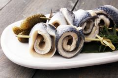 Traditional rollmops, stuffed pickled herring fillets,on a dish. Traditional rollmops, stuffed pickled herring fillets,on a dish Stock Images