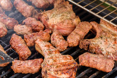 Traditional Romanian Barbecue With Pork Meat Rolls (Mici Or Mititei) Stock Photography
