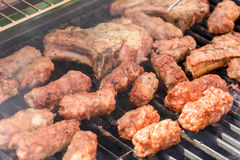 Traditional Romanian Barbecue With Pork Meat Rolls (Mici Or Mititei) Royalty Free Stock Photography