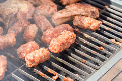 Traditional Romanian Barbecue With Pork Meat Rolls (Mici Or Mititei) Stock Photo