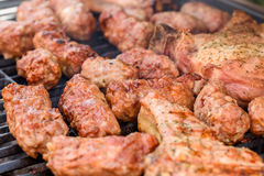 Traditional Romanian Barbecue With Pork Meat Rolls (Mici Or Mititei) Royalty Free Stock Photo
