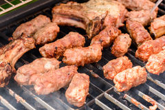 Traditional Romanian Barbecue With Pork Meat Rolls (Mici Or Mititei) Royalty Free Stock Image