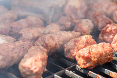 Traditional Romanian Barbecue With Pork Meat Rolls (Mici Or Mititei) Stock Image