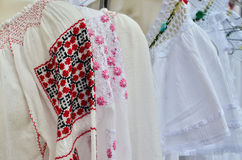 Traditional Romanian Blouses. (ie populara) on sale in a local market royalty free stock photography