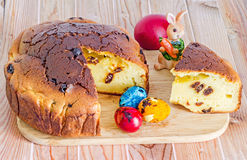 Traditional romanian cake called Pasca with colored easter eggs, bunny, wood background. royalty free stock images