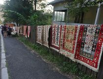 Traditional Romanian carpets at the street royalty free stock photography