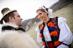 Traditional romanian costumes. Couple in love dressed in traditional clothes preparing for a traditional Romanian wedding. The photo is taken in Maramures Royalty Free Stock Photo