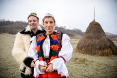 Traditional romanian costumes. Couple in love dressed in traditional clothes preparing for a traditional Romanian wedding. The photo is taken in Maramures royalty free stock image