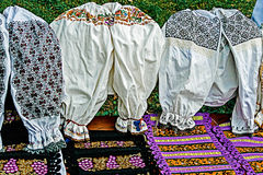 Traditional romanian costumes and materials embroidered Royalty Free Stock Images