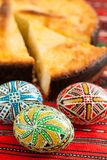 Traditional romanian easter bread pasca with cheese and raisins and nicely decorated easter eggs orthodox tradition. Traditional romanian easter bread pasca with Stock Photography